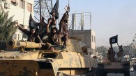 Fighters from the al-Qaida linked Islamic State group during a parade in Raqqa, Syria.
